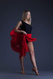 Pretty sensual woman dancing with red cloth Stock Photo