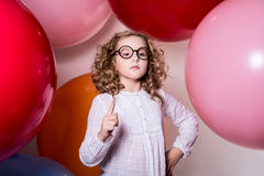 Pretty serious girl in a white dress with a raised index finger Royalty Free Stock Photography
