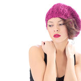 Pretty serious woman wearing pink hat. Isolated on white stock photo