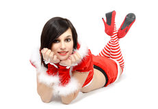 Pretty sexy girl dressed as Santa on the floor. Pretty sexy mother dressed as Santa on the floor Stock Image