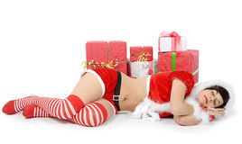 Pretty sexy girl dressed as Santa on the floor. Pretty sexy mother dressed as Santa on the floor Royalty Free Stock Images