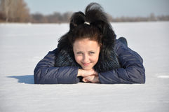 Pretty sexy girl laying on snow Stock Photos