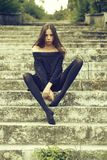 Pretty sexy girl on stairs stock photography