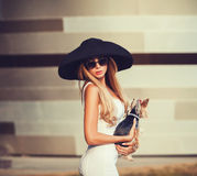 Pretty sexy girl with Yorkshire Terrier in the city. Young pretty sexy girl with Yorkshire Terrier in the city. Beauty, fashion Stock Image