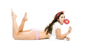 Pretty sexy pin up girl in panties and big lollipop Royalty Free Stock Image
