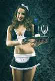 Pretty sexy vintage waitress on dark background Royalty Free Stock Images