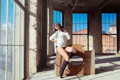 Pretty sexy woman at construction site near window Stock Photo