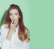Pretty woman or girl with long hair smoking cigarette. Young pretty woman or cute girl with long beautiful blonde hair and adorable surprised face smoking royalty free stock photography