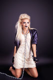 Pretty sexy woman in leather jacket with chain Royalty Free Stock Photo