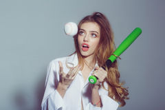 Pretty sexy woman with long hair holds green baseball bat Royalty Free Stock Photo