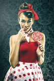 Pretty woman in red vintage polka dot dress - with lollipop Stock Photos