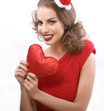 Pretty sexy woman in santas red hat isolated Stock Photography