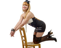 Pretty sexy woman with stockings on chair Stock Image