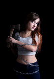 Pretty sexy woman tied with long metal chain with an ax Royalty Free Stock Image