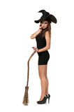 Pretty sexy young brunette witch with a broom Stock Images