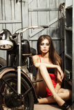 Pretty sexy young girl  near motorbike Royalty Free Stock Photo