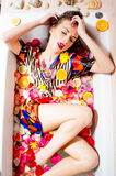 Beautiful sexy young lady in bath with flowers. Royalty Free Stock Photos