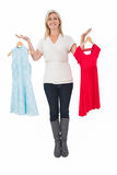 Pretty shopping blonde choosing a dress Royalty Free Stock Images