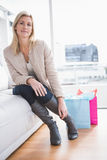 Pretty shopping blonde sitting on couch Stock Photos
