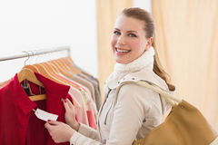 Pretty shopping blonde smiling at the camera Royalty Free Stock Photos