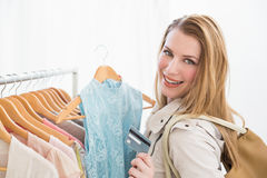 Pretty shopping blonde smiling at the camera Royalty Free Stock Image