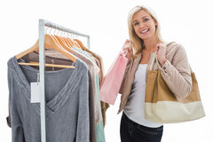 Pretty shopping blonde smiling at the camera Stock Photo
