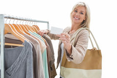 Pretty shopping blonde smiling at the camera Stock Image
