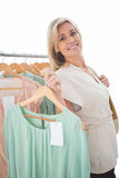 Pretty shopping blonde smiling at the camera Stock Photography
