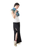 Pretty short hair fashion model wearing shawl and slit wide pants pointing at you Royalty Free Stock Photos