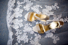Pretty shot of wedding shoes and wedding dress. Pretty shot of wedding shoes and a wedding dress Stock Photography