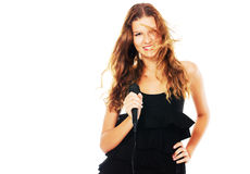 Pretty singer in a black dress Stock Photography