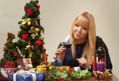 Pretty single woman celebrating christmas alone Royalty Free Stock Images