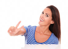 Pretty single woman making a victory sign royalty free stock photos