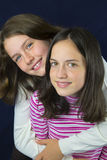 Pretty sisters with freckles smiling and hugging Royalty Free Stock Photos