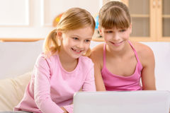 Pretty sisters having fun at home Stock Images