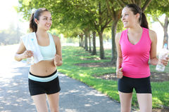 Pretty Sisters Jogging in Park Royalty Free Stock Photo