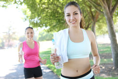 Pretty Sisters Jogging in Park Stock Photo