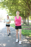 Pretty Sisters Jogging in Park Stock Image