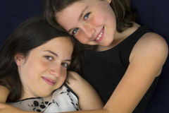 Pretty sisters smiling and hugging Royalty Free Stock Photo