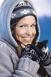 Pretty skier enjoying winter smiling Royalty Free Stock Images