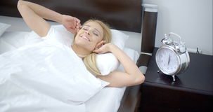 Pretty Sleeping Woman with Alarm Clock Next to Her stock footage