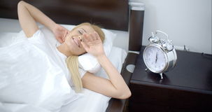 Pretty Sleeping Woman with Alarm Clock Next to Her stock video