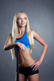 Pretty slim girl posing in studio with fitbar Royalty Free Stock Photos