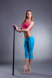 Pretty slim girl standing on tiptoe with fitbar Stock Photography