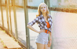Pretty slim model posing in the city, hipster girl Royalty Free Stock Photography