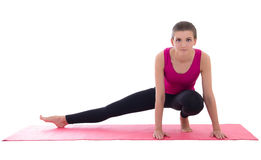Pretty slim woman doing stretching exercise on yoga mat isolated Royalty Free Stock Photos