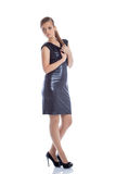Pretty slim woman posing in trendy cocktail dress Stock Images