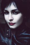 Pretty sly woman with red lips. Outdoors Stock Photos