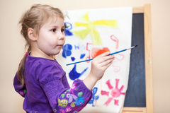 Pretty small child holding painting brush in hand Royalty Free Stock Images
