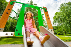 Pretty small girl on chute sitting and smiling Stock Photography
